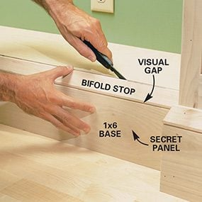 This photo shows how to open the secret compartment you built for the built-in bookcase.