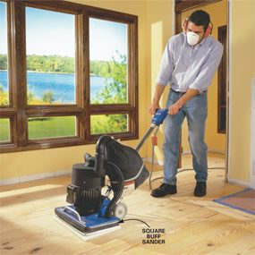 Person sanding with square sander