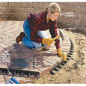 Pull the sand away from the perimeter of the patio