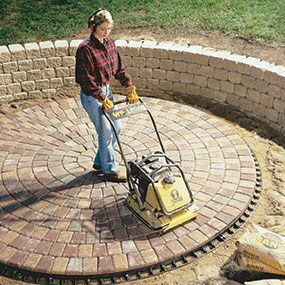 Run the plate compactor on top of the pavers