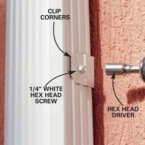 Photo 16: Attach the downspout to the brackets