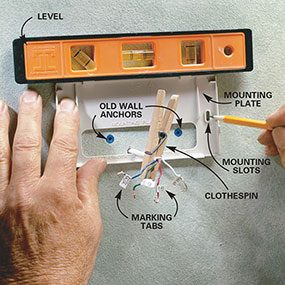 Photo 2 shows how to install the mounting plate for the programmable thermostat.