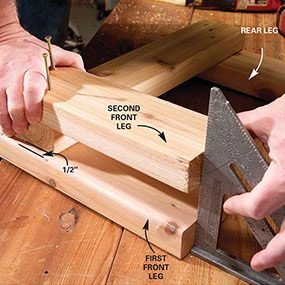 Finish building the front leg of the bench by attaching another leg.