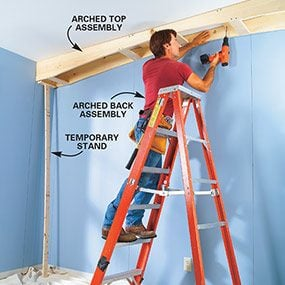Fasten the apron assembly for the top of the built-in bookcase to the ceiling.
