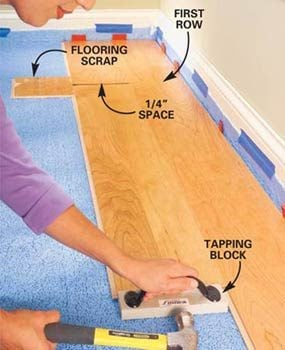 Photo 7: Tap the flooring pieces tightly together