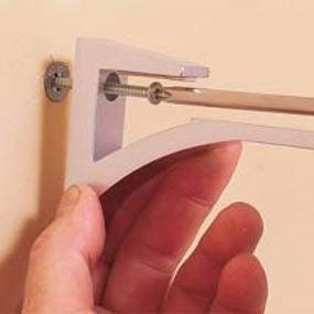 Photo 7: Install the brackets.