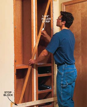 Photo 16: Pull the cabinets flush against the stop blocks.