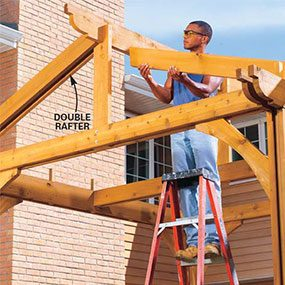 Set a rafter against the ridge beam, holding it 1-1/2 in. below the top edge