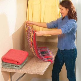 Fold-away folding table