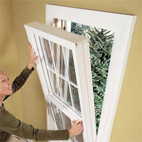 Replacement window inserts tilt into the existing frame.