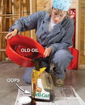 Pour old oil in a jug for recycling.