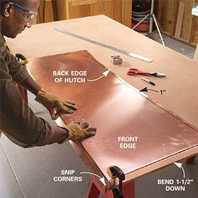 Step 15: Center the 24-in. wide copper sheet over the cabinet top with a 1-1/2 in. overhang in front