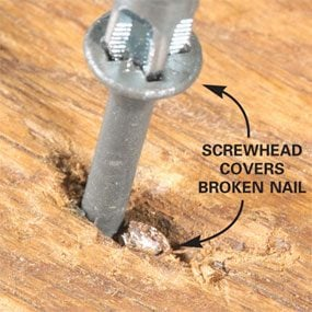 Screw beside nail