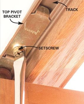 Photo 1: Adjust the top pivot bracket