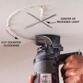 Making cutouts for fixtures when you hang drywall is easier with a spiral saw.