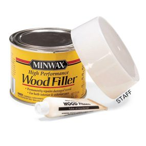 Use a two-part wood filler to fix damaged wood trim.