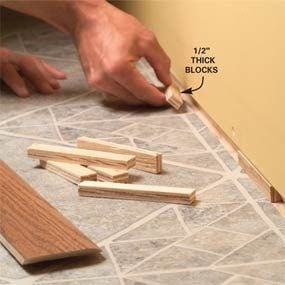 Fill the gap with blocks above vinyl or laminate floors