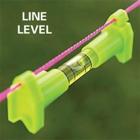 Use a line level to establish level and slope.