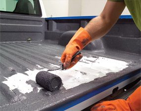 Roll the bed of the pickup truck with the brush-on bed liner.