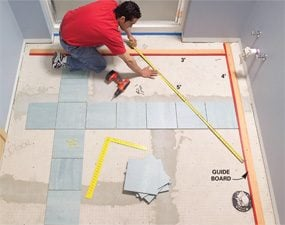 how to lay tile install a ceramic tile floor in the bathroom the family handyman