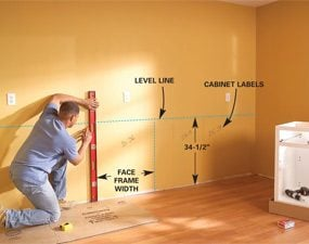 how to hang kitchen wall cabinets how to install kitchen cabinets the family handyman 17016