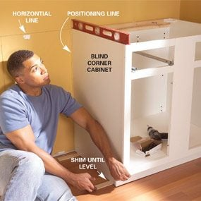 How To Install Lower Kitchen Cabinets installing kitchen cabinets | family handyman