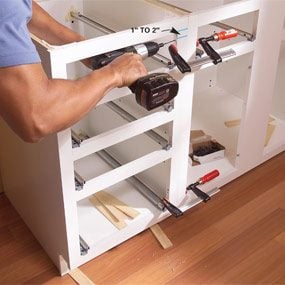 how to attach kitchen cabinets together installing kitchen cabinets the family handyman 16789