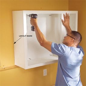 How To Install Upper Kitchen Cabinets How To Install Kitchen Cabinets  Family Handyman