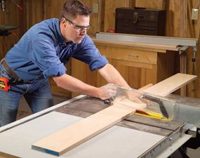Use a miter gauge to crosscut a board.