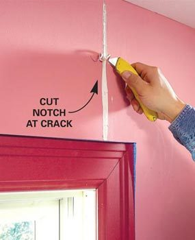 Use a utility knife to cut open the crack in a V shape.