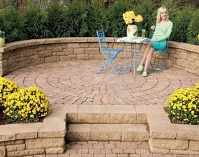 Add a patio and wall to the stone path.