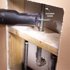 Cut the galvanized shower riser to make room for the shower faucet installation.