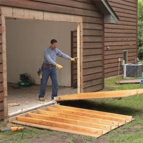 Get more garage storage with a bump out addition the for Best builders workshop deck