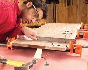 Shim or add extra clamps to eliminate bows in your glue-up.