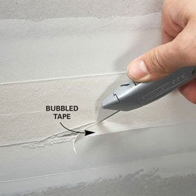 Completely remove all bubbled tape and remud.