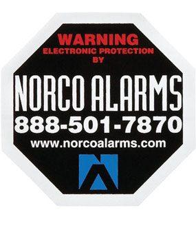 Alarm warning sticker on window