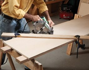 Cut the sides for the compact compressor cabinet with a circular saw.