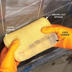 Remove excess grout with a sponge