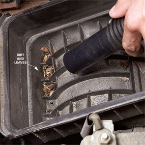 Remove the air filter and vacuum out any dirt.