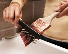 Use a wire brush to remove paint from bristles
