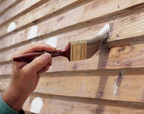 Spot-priming knots in wood siding