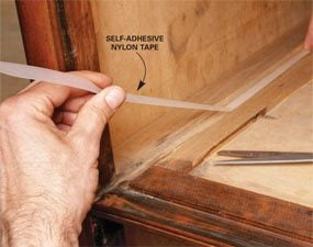 Self-adhesive nylon tape lubricates rubbing surfaces.