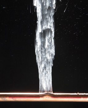 A burst water pipe in the home requires quick emergency action.