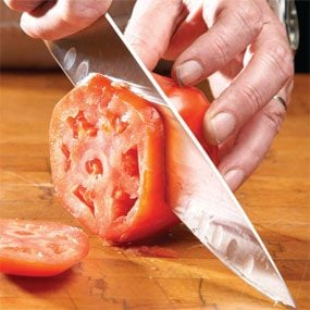 The knife is sharpened when it can easily slice a tomato.