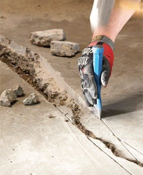 Diy concrete crack repair family handyman for Getting grease off concrete