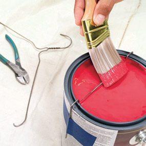 Coat hanger catches excess paint