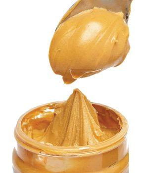 Creamy peanut butter on spoon