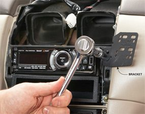 Photo 1: Attach the bracket to the radio