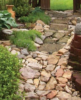A stone creek bed channels rainwater.