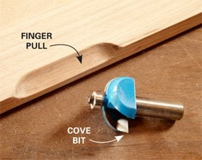 DIY Furniture Trick: Routed finger pulls made with cove bit.